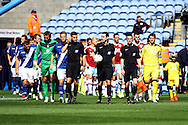 Referee David Coote and his assistants lead the teams out before k/o. Skybet football league championship match, Burnley  v Birmingham City at Turf Moor in Burnley, Lancs on Saturday 15th August 2015.<br /> pic by Chris Stading, Andrew Orchard sports photography.