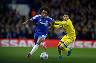Willian of Chelsea breaks away from Avi Rikan of Maccabi Tel Aviv. UEFA Champions League group G match, Chelsea v Maccabi Tel Aviv at Stamford Bridge in London on Wednesday 16th September 2015.<br /> pic by John Patrick Fletcher, Andrew Orchard sports photography.