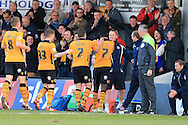 Medy Elito of Newport county celebrates with his manager Warren Feeney ® and his teammates after he scores his teams 1st goal to make it 1-1. Skybet football league two match, Newport county v Oxford Utd at Rodney Parade in Newport, South Wales on Tuesday 19th April 2016.<br /> pic by Andrew Orchard, Andrew Orchard sports photography.