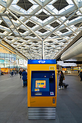 Ticket machine of Dutch Railways at Den Haag Centraal railway station in The Hague, Netherlands