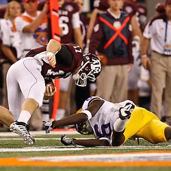 Jan 7, 2011; Arlington, TX, USA; LSU Tigers safety Craig Loston (6) tackles Texas A&M Aggies quarterback Ryan Tannehill (17) during the second half of the 2011 Cotton Bowl at Cowboys Stadium.  Mandatory Credit: Derick E. Hingle