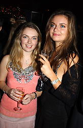 Left to right, sisters LADY SYBILLA RUFUS-ISAACS and LADY NATASHA RUFUS-ISAACS at a party hosted by Tatler magazine to celebrate the publication of the 2004 Little Black Book held at Tramp, 38 Jermyn Street, London SW1 on 10th November 2004.<br />