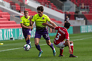 Exeter City's Josh Key (30) avoids the tackle of Bristol City's Jay Dasilva (3) during the EFL Cup match between Bristol City and Exeter City at Ashton Gate, Bristol, England on 5 September 2020.