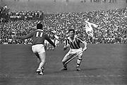 07/09/1969<br /> 09/07/1969<br /> 7 September 1969<br /> All-Ireland Senior Hurling Final: Kilkenny v Cork at Croke Park, Dublin.  <br /> P.O. Dulainne (Kilkenny forward) with the ball tries to get past Cork forward, C.O. Cuilleanain (11).