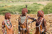 Hamer Women anxiously wait at the traditional whipping ritual. Omo Valley, Ethiopia