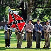 The honor guard, of Confederate re-enactors, watch during the  formal Confederate memorial ceremony  for Pvt. Haywood Treadwell of the 61st NC Volunteers, Co. G, at the Beaufort National Cemetery on May 10, 2014. Pvt. Haywood Treadwell of the 61st NC Volunteers, Co. G, was the only Confederate soldier interred in the Beaufort National Cemetery with a tombstone marked as unknown.