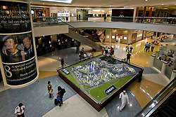 Dubai's air conditioned malls showcase sales displays with models of new real estate developments