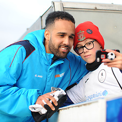 TELFORD COPYRIGHT MIKE SHERIDAN Brendon Daniels poses for a picture with a young Telford fan during the Vanarama Conference North fixture between AFC Telford and Farsley Celtic at the New Bucks head Stadium on Saturday, December 7, 2019.<br /> <br /> Picture credit: Mike Sheridan/Ultrapress<br /> <br /> MS201920-033