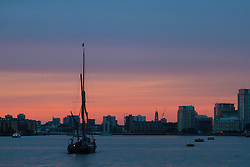 London, July 17th 2017. London Historians and Georgian Dining Academy celebrate the 300th anniversary of George Frederic Handel's masterpiece, The Water Music on the pleasure boat Golden Jubilee on the River Thames in London. PICTURED: A Thames sailing barge makes its way up-river as the last rays of the sun illuminate the clouds.