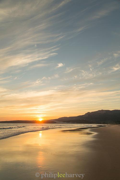 Bolonia beach at sunset in Cadiz, Spain