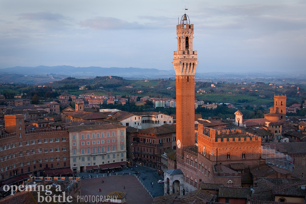 Torre del Mangia and Piazza del Campo at dusk, as seen from Museo dell'Opera. Siena, Tuscany, Italy.