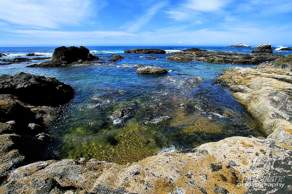 Beautiful blue water in a mini cove at low tied near Lincoln City, OR at the Oregon Coast