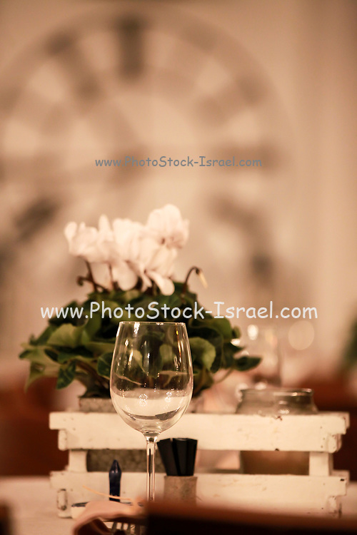 Atmospheric image of a Festive table setting with flowers for a formal dinner