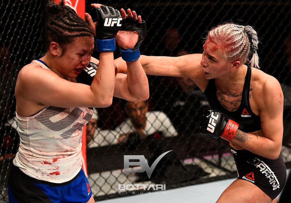 LAS VEGAS, NV - DECEMBER 03:  (R-L) Kailin Curran punches Jamie Moyle in their women's strawweight bout during The Ultimate Fighter Finale event inside the Pearl concert theater at the Palms Resort & Casino on December 3, 2016 in Las Vegas, Nevada. (Photo by Jeff Bottari/Zuffa LLC/Zuffa LLC via Getty Images)