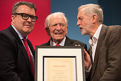 © Licensed to London News Pictures . 27/09/2015 . Brighton , UK . JOHN HEED (c) (100) is presented with a merit award by TOM WATSON (l) and JEREMY CORNYN (r) at the 2015 Labour Party Conference . Photo credit : Joel Goodman/LNP