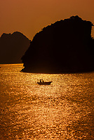 Sunset in Halong Bay, North Vietnam. The bay features 3,000  limestone and dolomite karsts and islets in various shapes and sizes sprinkled over 1,500 square kilometers. It offers a wonderland of karst topography. It is a UNESCO World Heritage Site.