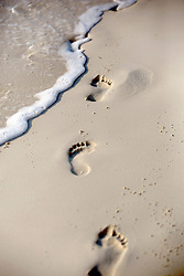 10 Feb 2014. Cancun, Mexico.<br /> Footprints in the sand on the tourist beach at Isla Cancun along the Zona Hotelera on the Carribean Sea. <br /> Photo; Charlie Varley/varleypix.com