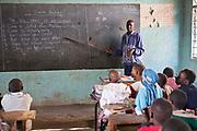 Mr Ngugi teaching Phase 1 at Mathare School in Nairobi, Kenya. Undugu Society of Kenya (USK), an NGO who run various programmes to help the school and children.
