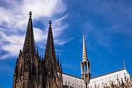 clouds above the steeples of the cathedral, Cologne, Germany.<br /> <br /> Wolken uber den Turmspitzen des Doms, Koeln, Deutschland.
