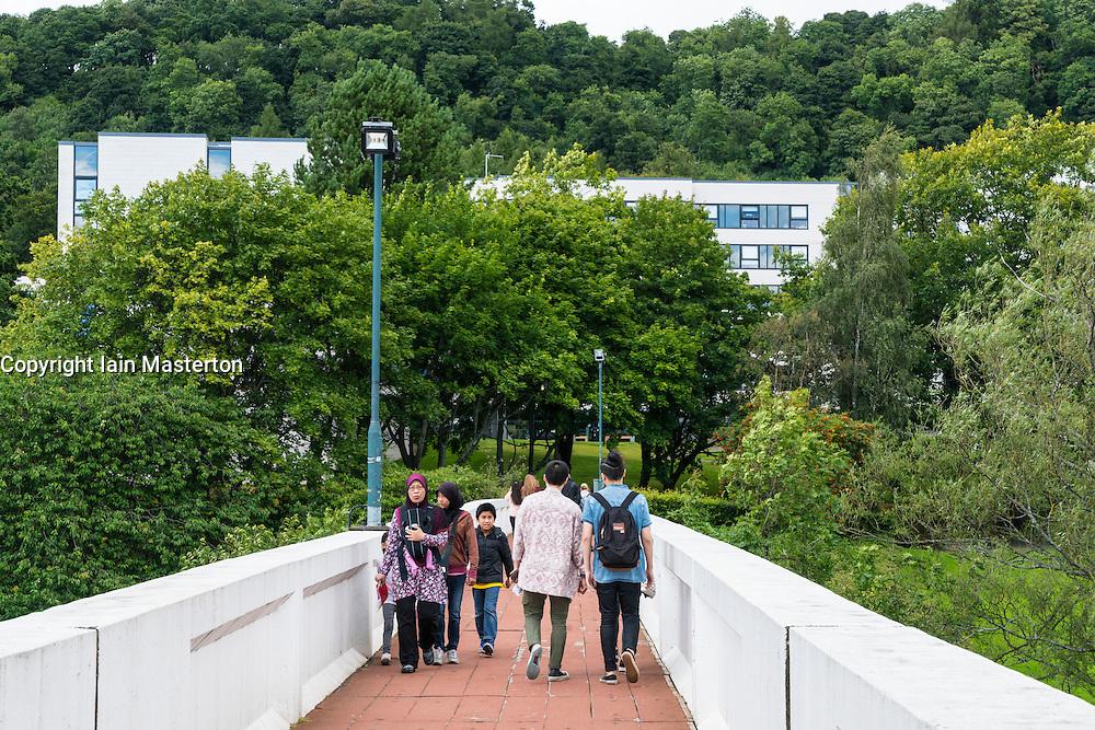 People of footbridge on campus at Stirling University in Scotland , united Kingdom
