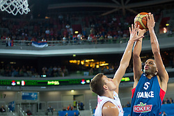 Nicolas Batum #5 of France shoots against Bogdan Bogdanovic #7 of Serbia during basketball match between national team of Serbia and France of Eurobasket 2013 on September 15, 2013 in SRC Stozice, Ljubljana, Slovenia. (Photo By Matic Klansek Velej / Sportida.com)