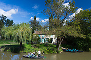Tourists on barge along canal by Coulon in the Marais Poitrevin region a Grand Site de France
