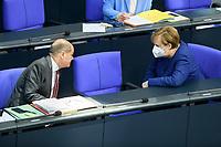 08 DEC 2020, BERLIN/GERMANY:<br /> Angela Merkel (L), CDU, Bundeskanzlerin, und Olaf Scholz, MdB, SPD, Bundesfinanzminister, mit Mundschutz, im Gespraech, Haushaltsdebatte, Plenum, Reichstagsgebaeude, Deuscher Bundestag<br /> IMAGE: 20201208-02-045<br /> KEYWORDS: Mund-Nase-Schutz, Gespräch, Corona, Corvid-19
