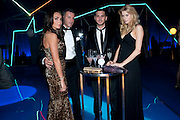 TAMARA ECCLESTONE; ROB MONTAGUE;  ANDREW DANENZA; LAUREN YEARWOOD. ; , Grey Goose character and cocktails. The Elton John Aids Foundation Winter Ball. off Nine Elms Lane. London SW8. 30 October 2010. -DO NOT ARCHIVE-© Copyright Photograph by Dafydd Jones. 248 Clapham Rd. London SW9 0PZ. Tel 0207 820 0771. www.dafjones.com.