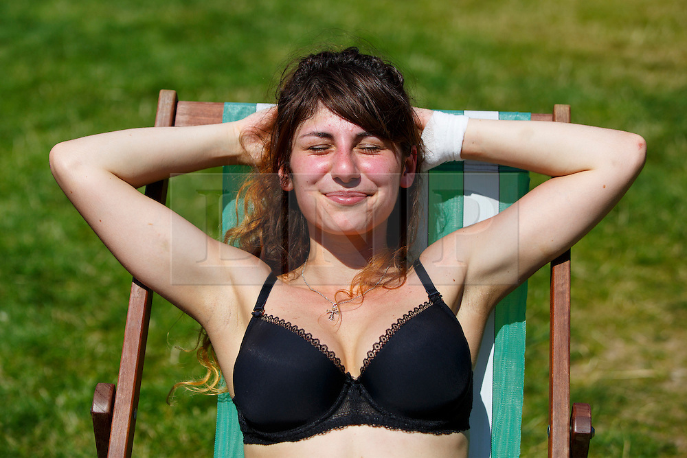 © Licensed to London News Pictures. 19/07/2016. London, UK. Kasia Kusiak sunbathes as people enjoy the hottest day of the year so far in the UK in Green Park in London on Tuesday, 19 July 2016. Photo credit: Tolga Akmen/LNP