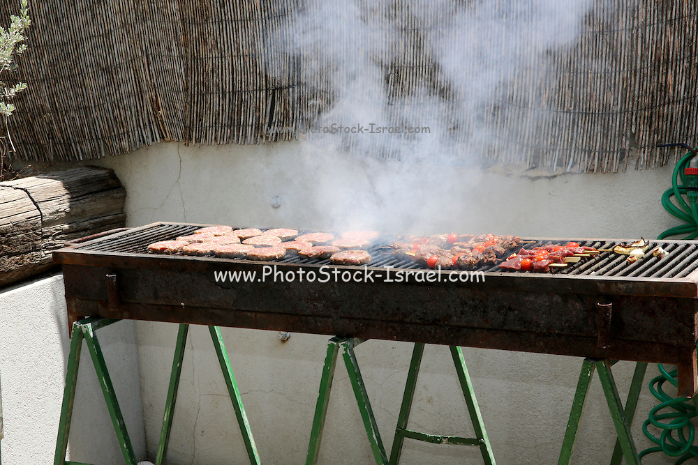 meat cooking on a barbecue now believed to cause cancer