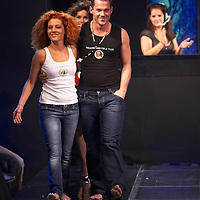 Hungarian celebrities Ferenc Hujber (L) and Cinthia (R) present collections by Pussy Deluxe and Vive Maria during the opening underwear fashion show of the new event hall called Show-Room in Budapest, Hungary on October 26, 2007. ATTILA VOLGYI