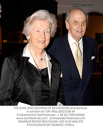 THE DUKE AND DUCHESS OF DEVONSHIRE at a lectrure in London on 13th May 2002.	OZX 49