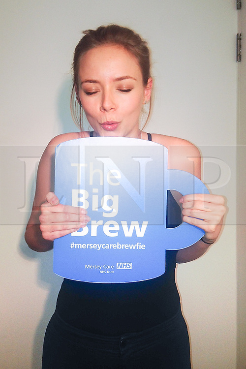 """© Licensed to London News Pictures . 19/01/2015 . Liverpool , UK . Sacha Parkinson from Coronation Street and The Mill . Celebrities pose with """" Big Brew """" placards in support of mental health awareness as today (19th January 2015) marks """" Blue Monday """" , the day regarded by many as the most depressing in the year . Campaigners are urging the public to show support by tweeting sefies with their favourite brew and the hashtag """" #brewfie """" . In London , Deputy Prime Minister Nick Clegg , is announcing his campaign to improve mental health awareness , reduce stigma and promote a """" zero ambition """" target for suicide . Photo credit : Joel Goodman/LNP"""