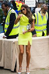 Ascot, UK. 20 June, 2019. A racegoer in a fluorescent dress attends Ladies Day at Royal Ascot.