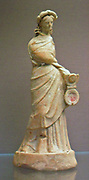 Terracotta figure of a woman holding a hinged box-mirror.  Made in Boeotia about 230-200 BC.  Said to be from Tangagra