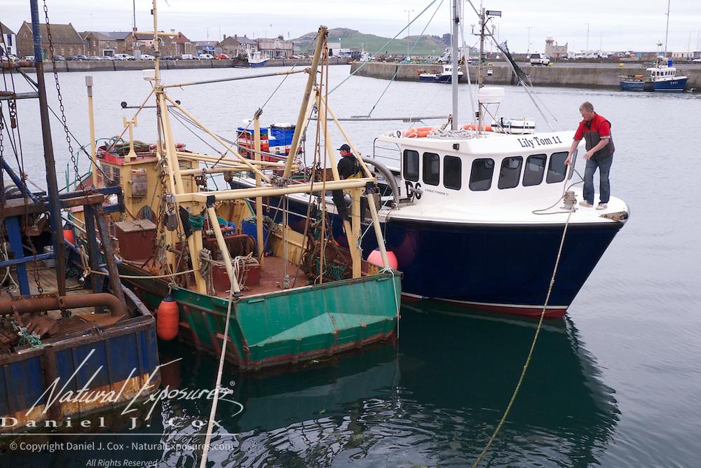 Small fishing boats in Howth Harbor, Dublin, Ireland.