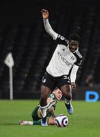 Football - 2020 / 2021 Premier League - Fulham vs Sheffield United - Craven Cottage<br /> <br /> Fulham's Ola Aina is tackled by Sheffield United's Billy Sharp.<br /> <br /> COLORSPORT/ASHLEY WESTERN