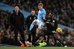 Manchester City's Kevin De Bruyne (left) and West Ham United's Michail Antonio battle for the ball