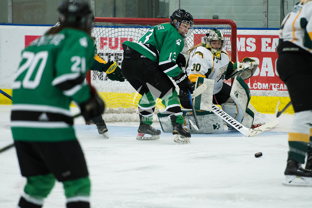 2nd year goalie Morgan Baker (30) of the Regina Cougars in action during the Women's Hockey Homeopener on October 7 at Co-operators arena. Credit: Arthur Ward/Arthur Images