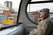 Elderly man takes the bus into Dudley, Birmingham, England, United Kingdom.