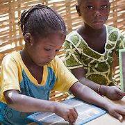 Hard at work at Koumbadiouma's primary school. Kolda, Senegal.