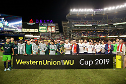 NEW YORK, NEW YORK, USA - Wednesday, July 24, 2019: Liverpool's captain Jordan Henderson (R) and Sporting CF's captain Bruno Fernandes share the Western Union Cup after a friendly match between Liverpool FC and Sporting Clube de Portugal at the Yankee Stadium on day nine of the club's pre-season tour of America. The game ended in a 2-2 draw. (Pic by David Rawcliffe/Propaganda)