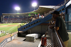 SIde view of the bleachers and a fan. Furthur Band at McCoy Stadium, Pawtucket RI on 5 July 2012