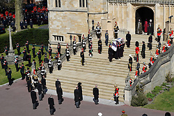 The Duke of Edinburgh's coffin, covered with his Personal Standard, is carried to the chapel entrance as the Princess Royal, the Prince of Wales, the Duke of York, the Earl of Wessex, the Duke of Cambridge, Peter Phillips, the Duke of Sussex, the Earl of Snowdon and Vice Admiral Sir Timothy Laurence wait at the foot of the steps at St George's Chapel, Windsor Castle, Berkshire, ahead of the funeral of the Duke of Edinburgh. Picture date: Saturday April 17, 2021.