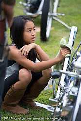 Invited builder Kosuke Saito's children polish his custom 1936 Harley-Davidson Knucklehead (that Bill Buckingham rode in the 2014 Motorcycle Cannonball) on Day one of the Born Free Vintage Chopper and Classic Motorcycle Show at the Oak Canyon Ranch in Silverado, CA. USA. Saturday, June 28, 2014.  Photography ©2014 Michael Lichter.