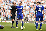 John Terry of Chelsea speaks to Referee Mike Dean.Barclays premier league match, Manchester city v Chelsea at the Etihad stadium in Manchester,Lancs on Sunday 21st Sept 2014<br /> pic by Andrew Orchard, Andrew Orchard sports photography.