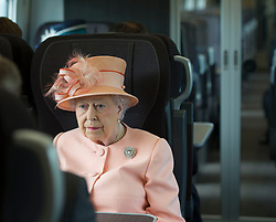 Queen Elizabeth II on a train travelling from Slough to Paddington Station to mark the 175th anniversary of the first train journey by a British monarch.