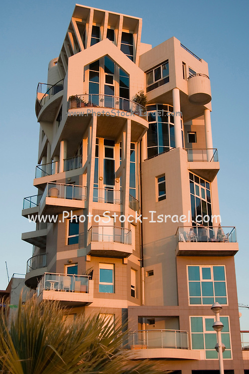Israel, A modern building in Trumpeldor street on the Tel Aviv beach front at sun set October 2005