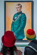 Boy George (R) and friend visit - The Royal Society of Portrait Painters Annual Exhibition at the Mall Galleries. It includes over 200 portraits by over 100 artists.