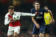 Edinson Cavani of Paris Saint-Germain and Alex Oxlade-Chamberlain of Arsenal chase the ball. UEFA Champions league group A match, Arsenal v Paris Saint Germain at the Emirates Stadium in London on Wednesday 23rd November 2016.<br /> pic by John Patrick Fletcher, Andrew Orchard sports photography.